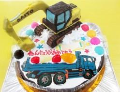 パワーショベルとトラックのケーキ