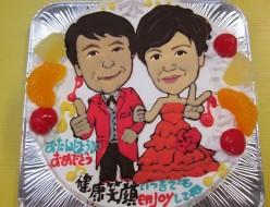 赤のタキシードと赤のドレス還暦似顔絵ケーキ