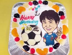 サッカーイメージの似顔絵ケーキ
